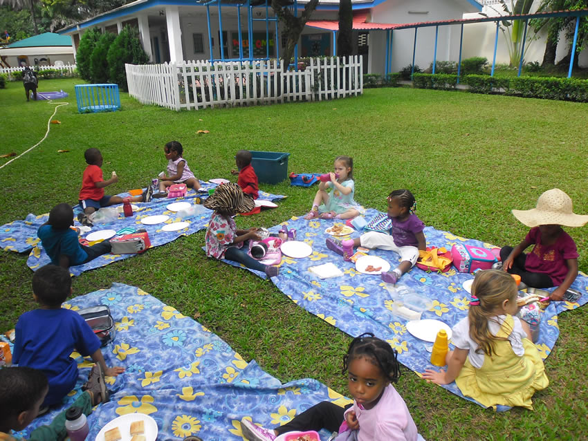 DONALD CLASS ENJOYS A PICNIC OUTDOORS